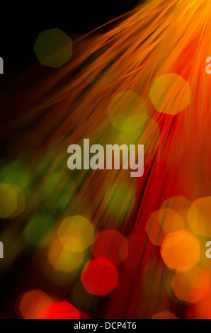 Bokeh out of focus lights light aesthetically pleasing colors fiber optics communication cable channels - Stock Photo