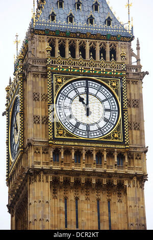 The dial of The Great Clock of Westminster shows the time as 11am as Big Ben chimes to mark Armistice Day (Remembrance - Stock Photo