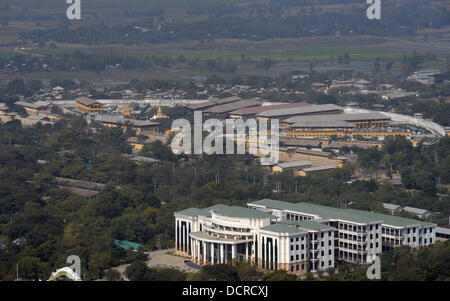 View from Mandalay Hill towards university of traditional medicine and the prison with its pagoda - Stock Photo