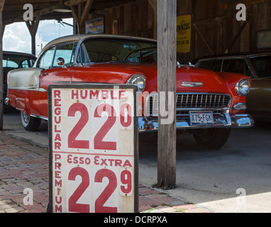 San Antonio, Texas - A Chevrolet from the 1950s and a gasoline price sign on display at the SAS shoe factory and - Stock Photo