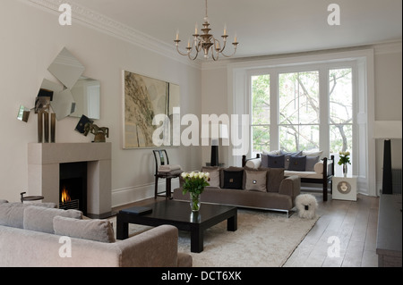 Open fire with neutral decoration in 19th century Kensington family home - Stock Photo