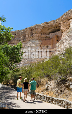 Tourists at Montezuma Castle National Monument, well preserved cliff dwelling of Sinagua people, near Camp Verde, - Stock Photo