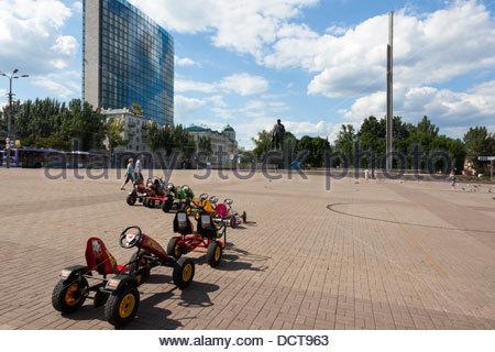 Children's pedal cars / karts . Lenin Square Donetsk Ukraine - Stock Photo