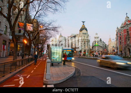 Cycle lane and bus stop at dawn. Alcala street, Madrid, Spain. - Stock Photo