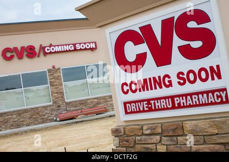 A newly built CVS Pharmacy with a 'Coming Soon' sign.