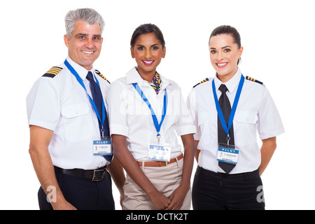 beautiful airline crew standing on white background - Stock Photo