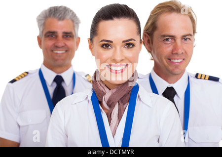 beautiful flight attendant standing in front of two pilots - Stock Photo