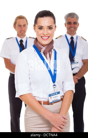 attractive airhostess standing in front of pilots on white background - Stock Photo