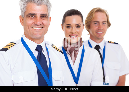 smiling middle aged pilot and crew isolated on white - Stock Photo