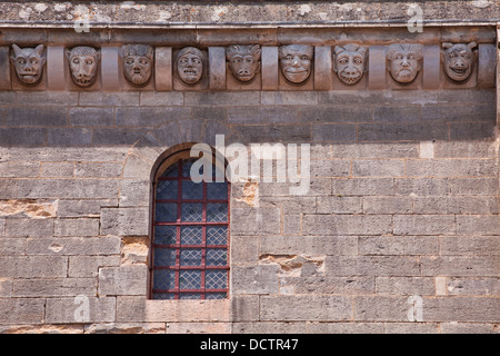 Carved stone heads on the side of the Basilique Sainte-Marie-Madeleine in Vezelay. - Stock Photo