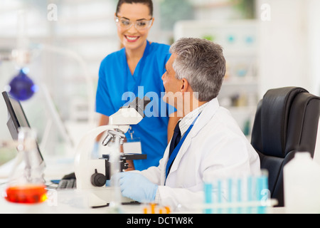 two scientists working in a lab - Stock Photo