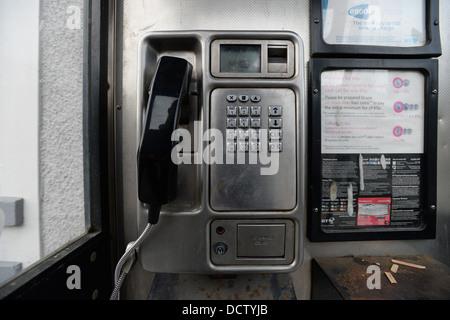 The inside of a British Telecom (BT) telephone box. - Stock Photo