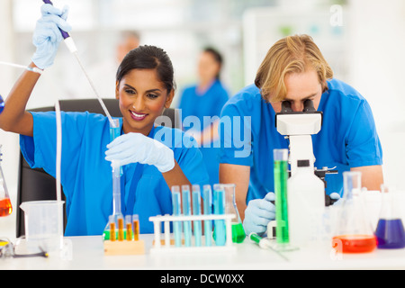 two scientists working in chemical laboratory - Stock Photo