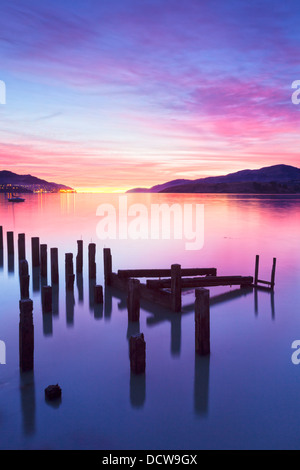 Beautiful sunrise with colours of pink, orange and purple, over Governors Bay, Canterbury New Zealand. In the foreground... - Stock Photo