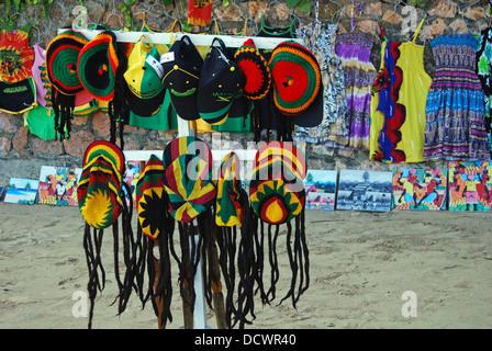 Novelty rasta hats and caps for sale on the beach, Ocho Rios, Middlesex County, Jamaica, Caribbean. - Stock Photo
