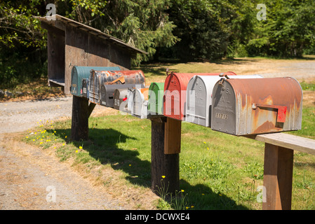 Roadside mailboxes on a country road. - Stock Photo