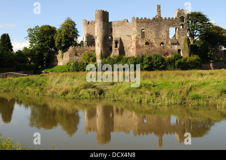 Laugharne Castle reflected in the Taf Estuary  Carmarthenshire Wales Cymru UK GB - Stock Photo