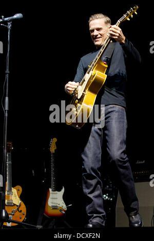 Bryan adams performing live on stage at the birmingham lg - Bryan adams room service live in lisbon ...