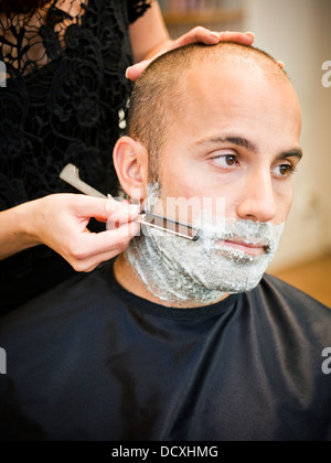Shaving at the hair salon - Stock Photo