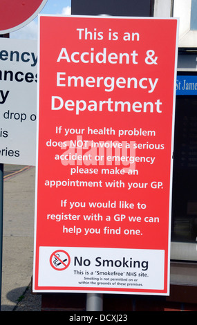 A sign in a hospital car park asking that only serious health problems seek help in their accident and emergency - Stock Photo