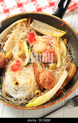 Dish of meatballs with cellophane noodles and vegetables - Stock Photo