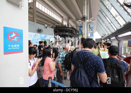 Queue for the cable car at Ngong Ping 360, Lantau Island, Hong Kong, China - Stock Photo