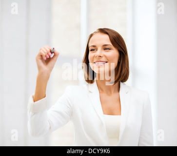 businesswoman writing in the air - Stock Photo