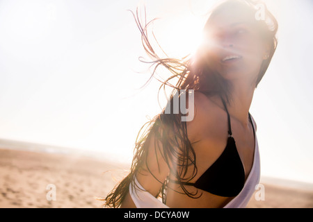 Young Woman on Beach with Windswept Hair - Stock Photo