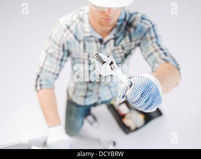 man with ladder, toolkit and spanner - Stock Photo