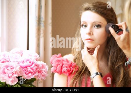Teenage Girl Having Makeup Applied - Stock Photo