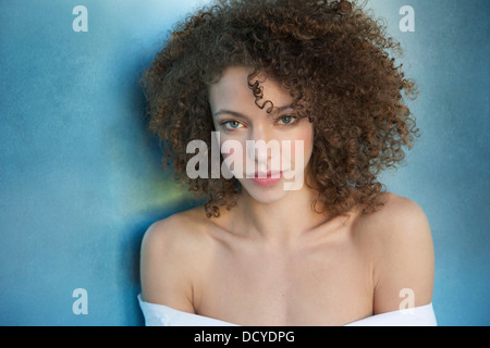 Portrait of Young Woman with Curly Hair - Stock Photo