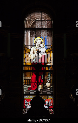 Stained glass window in Saint Nicholas Church (Dutch: Sint Nicolaaskerk) in Amsterdam, Holland, Netherlands. - Stock Photo
