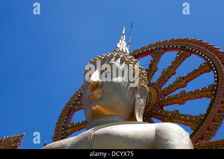 A buddha statue at Wat Phra Yai, Temple of the Big Buddha on Ko Samui Island in the Gulf of Thailand. - Stock Photo