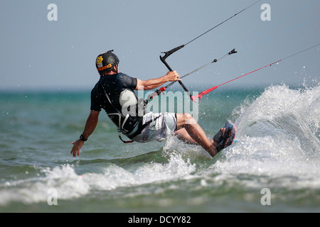 A kiteboarder heading offshore on a lake. - Stock Photo