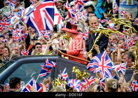 Queen Elizabeth II and Duke of Edinburgh travel along Mall during Golden Jubilee celebrations in London in 2002 - Stock Photo