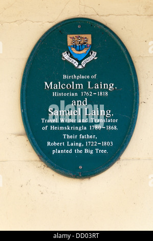 A plaque in Kirkwall records the birthplace of members of the Laing family and the planting of the Big Tree. - Stock Photo