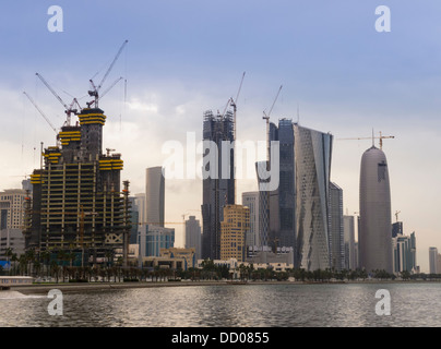 Panoramic view of many building cranes and active construction sites on the skyline in Doha, Qatar, Middle East - Stock Photo