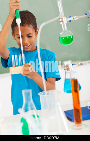 cute elementary school student in science class - Stock Photo