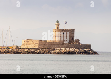 Agios Nikolaos Lighthouse, Mandraki Harbour, Rhodes, Greece - Stock Photo