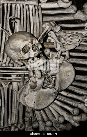 Human Bones and skulls decorating interior of the small Roman Catholic Sedlec Ossuary Bone Chapel in Sedlec suburb - Stock Photo