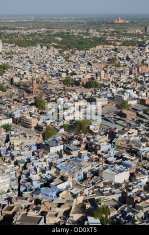 Aerial view of The blue city Jodhpur, Rajashtan, India. Sardar Market clock tower top left of image. - Stock Photo