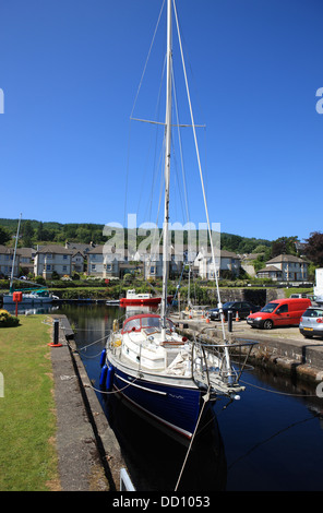 Yachts moored at the Ardrishaig basin and eastern entrance to the Crinan Canal in Argyll, Scotand - Stock Photo