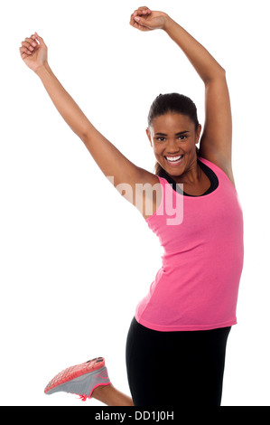 Beautiful fitness freak in sporty outfit jumping high in the air. - Stock Photo