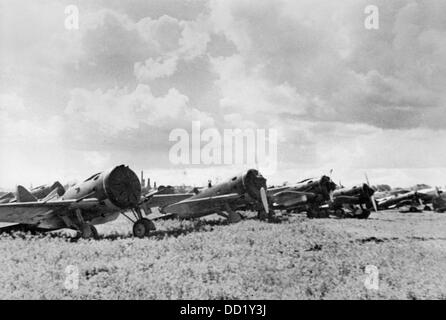 The image from the Nazi Propaganda! shows captured Soviet single-engine fighter airplane at a field airdome in Lithuania - Stock Photo