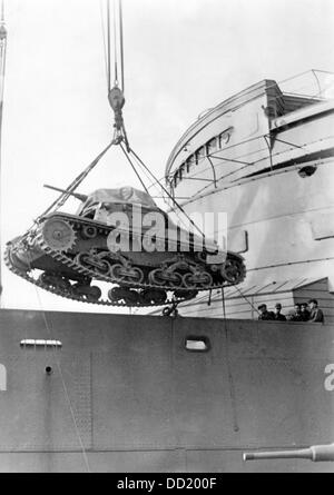 A track-laying vehicle is mounted onto a ship of the German Wehrmacht in Germany, published on 15 January 1942. - Stock Photo