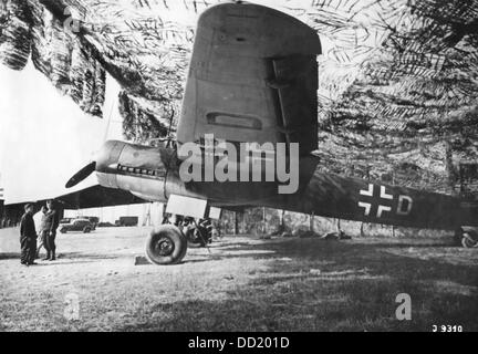 A camouflaged airplane of the German Wehrmacht is pictured in Tunisia. Date and place unknown. Photo: Berliner Verlag/Archiv - Stock Photo