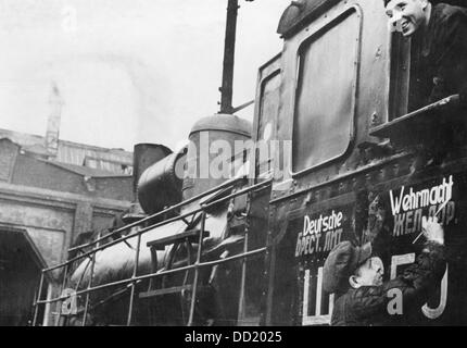 The image from the Nazi Propaganda! shows captured Soviet locomotives that are prepared for employment by the German - Stock Photo