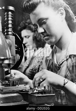 The image from the Nazi Propaganda! shows young women wokring in the defense industry; their Kriegshilfsdienst (KHD - Stock Photo