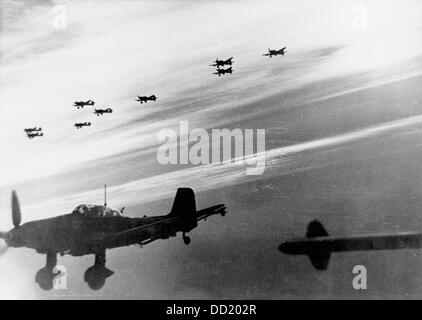 Dive bombers of the type Junkers Ju 87 flying a mission for the German Wehrmacht in February 1944. The Nazi Propaganda! - Stock Photo