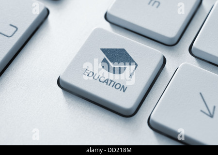 Button with graduation cap icon on a modern computer keyboard. Online education concept. - Stock Photo
